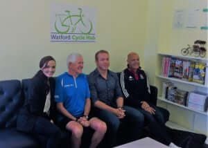 Dennis Fitton in blue top between Victoria Pendleton and Chris Hoy